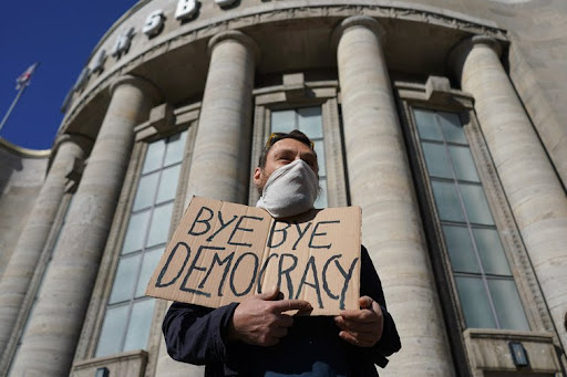 Democracy in the COVID-19 Crisis: Understanding the Fault Lines