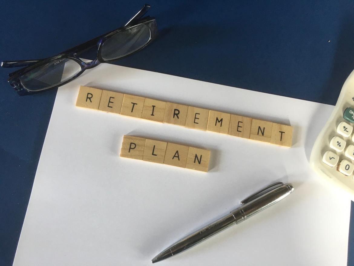 Retirement plan in block letters on notebook pad.