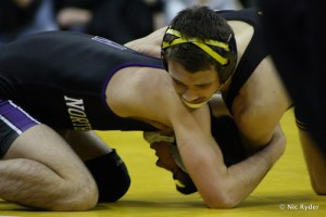 Thomas Gilman works for control over Northwestern's Garrison White in a dual earlier this year