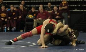 Cornell's Nahshon Garrett works for control against Minnesota's Ethan Lizak