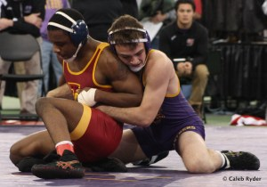 UNI's Jesse Etherington works to keep ISU's John Meeks under control in a match at the UNI Open