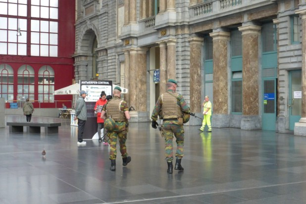 Armed soldiers keeping a watchful eye.