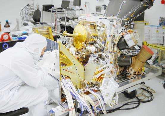 A IberEspacio worker doing the integration of thermal blankets into the Sentinel 3B