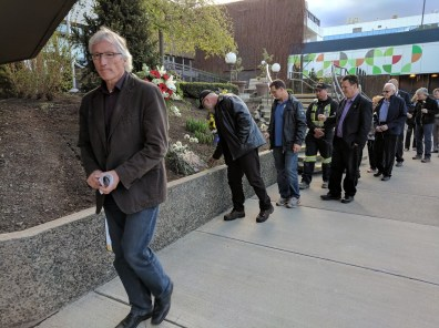 City councillor Denis Walsh, IBEW 993 Business Manager Glen Hilton laying his carnation, and Lyle Harpe on deck.