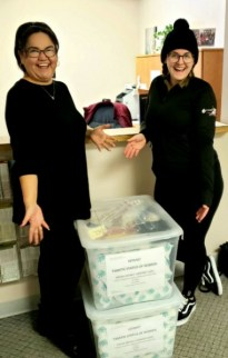 Priscilla from the Tamik Status of Women and IBEW 993 apprentice wireman Taylah Kaberry from Houle electric assiting with delivery of the Comfort Cases
