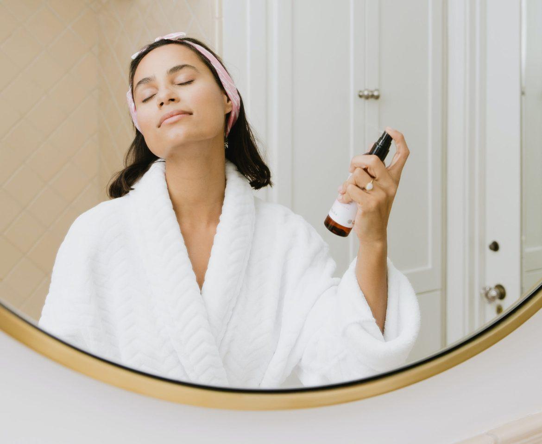 woman spraying skincare