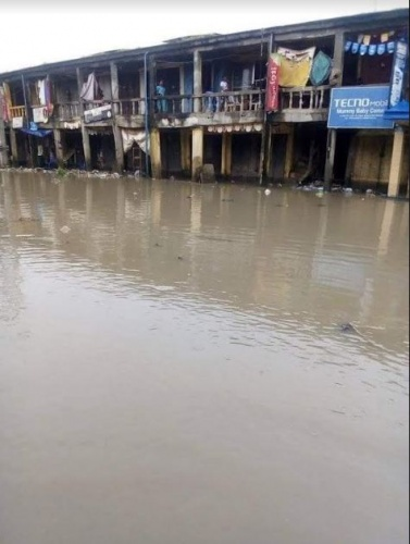 Photo: Traders count loses, as flood takes over Ariaria Int'l market in Aba