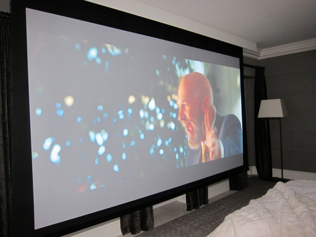 Commercial grade projector in a bedroom  Brightside