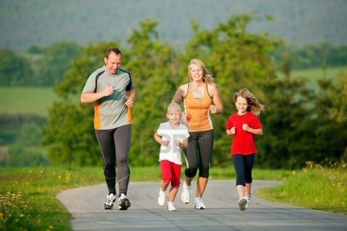 6117171-family-doing-sport-by-jogging-outdoors-with-the-kids-in-a-beautiful-summer-landscape-in-the-late-aft