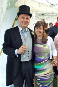 The handsome groom and his five-hundred-pound top hat; me and my fascinator.