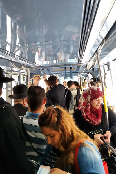 Image result for пассажиры внутри иерусалимского трамвая