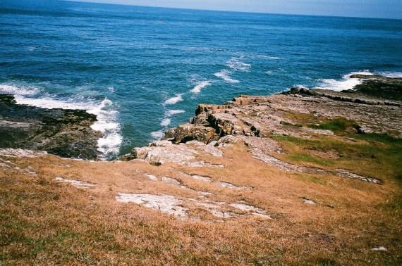 waves crashing on cliffs