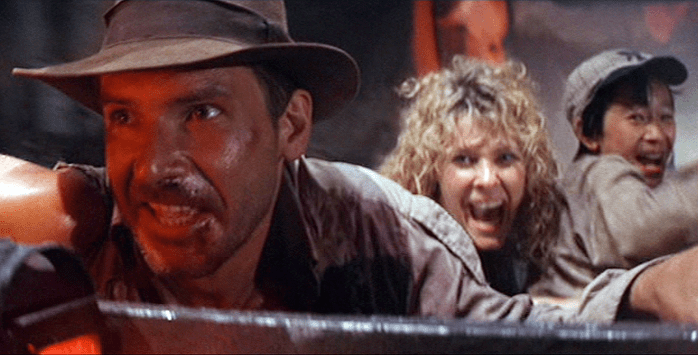 Harrison Ford, Kate Capshaw, and Ke Huy Quan star in the RAIDERS prequel INDIANA JONES AND THE TEMPLE OF DOOM (1984)
