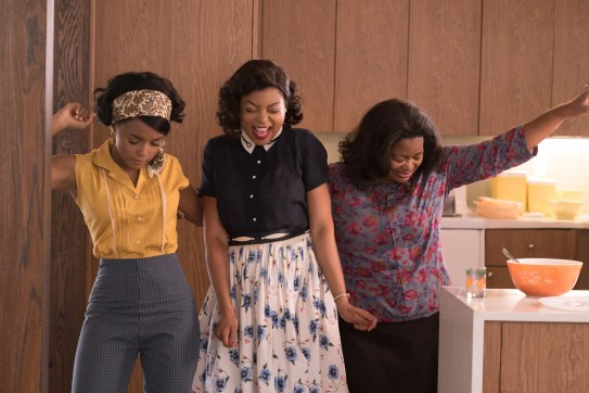 DF-03283_R3 - Mary Jackson (Janelle Monae, left), Katherine Johnson (Taraji P. Henson) and Dorothy Vaughn (Octavia Spencer) celebrate their stunning achievements in one of the greatest operations in history. Photo Credit: Hopper Stone.