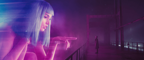 Ryan Gosling stares at a projection in BLADE RUNNER 2049.