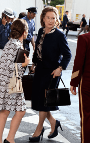 Meryl Streep as Washington Post publisher Kay Graham, on set of THE PAPERS. Steven Spielberg in background with white hat.