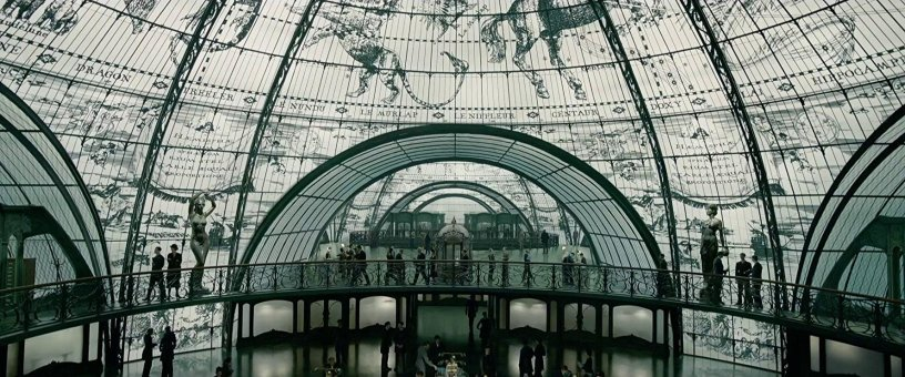 A spectacular glass foyer in FANTASTIC BEASTS: THE CRIMES OF GRINDELWALD