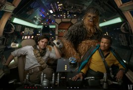 Oscar Isaac (Poe Dameron), Joonas Suotamo (Chewbacca), and Billy Dee Williams (Lando Calrissian) in the cockpit of the Millenium Falcon with BB-8 in STAR WARS: THE RISE OF SKYWALKER (2019)