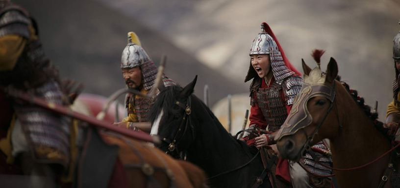 Yifei Liu prepares to charge for battle in the title role of Disney's live action remake of MULAN (2020)