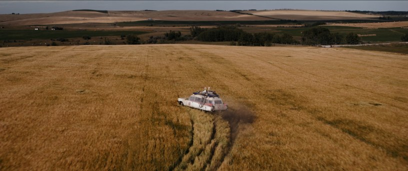 The Ecto-1 Ectomobile goes for a spin through an Oklahoma field in GHOSTBUSTERS: AFTERLIFE (2020)