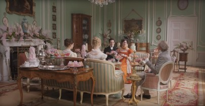 Friends gather in a tea room in EMMA. (2020)
