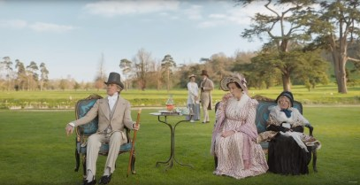 A garden party with Mr. Woodhouse (Bill Nighy) and Miss Bates (Miranda Hart) in EMMA. (2020)