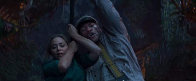 Emily Blunt and Dwayne Johnson hang on for their lives in the new Disney family adventure JUNGLE CRUISE (2020)