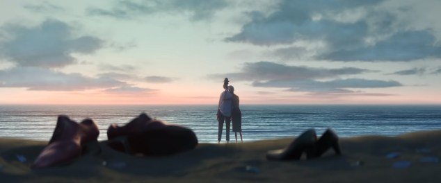 Joe Gardner (voice of Jamie Foxx) and a companion watch the sunset on a beach in Pixar's SOUL (2020)