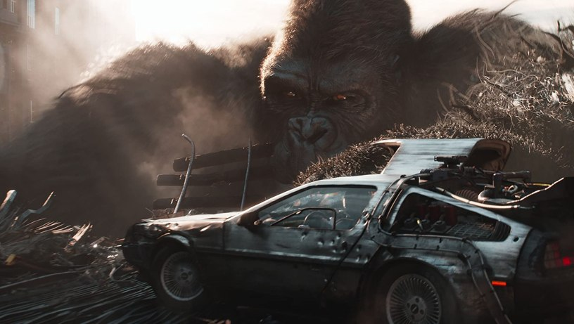 King Kong blocks Wade Watts' DeLorean in a VR race set in Steven Spielberg's adaptation of READY PLAYER ONE (2018)