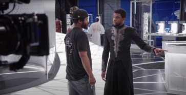 Director Ryan Coogler talks with actor Chadwick Boseman on the set of Marvel's BLACK PANTHER (2018)