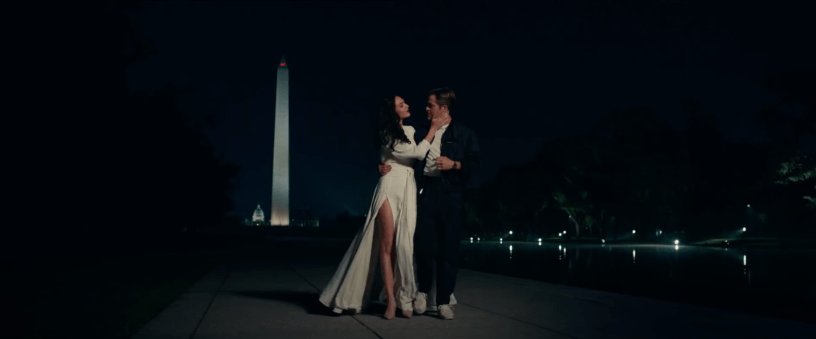 Diana Prince (Gal Gadot) and Steve Trevor (Chris Pine) walk along the grounds of the Washington Memorial in the DCEU sequel WONDER WOMAN 1984 (2020)