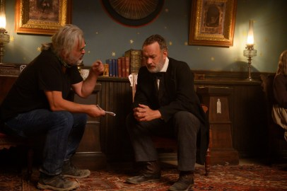 (from left) Director and co-writer Paul Greengrass and star Tom Hanks on the set of News of the World.