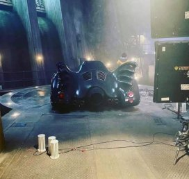 A rear view of The Batmobile parked on the set of THE FLASH (2022)