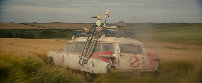 The Ecto-1 being driven through an Oklahoma field in the franchise reboot GHOSTBUSTERS: AFTERLIFE (2021)