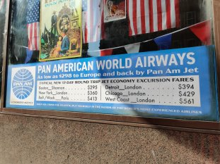 A display of PAN AM ticket fares, on the Glasgow set of INDY 5.