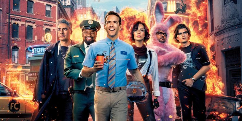 Ryan Reynolds (center) leads a cast co-starring (from L to R) Taika Waititi, Lil Rel Howery, Jodie Comer, Utkarsh Ambudkar, and Joe Keery in FREE GUY (2021)