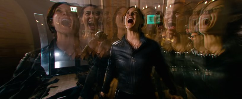 Trinity (Carrie-Anne Moss) experiences a ripple in the matrix in THE MATRIX RESURRECTIONS (2021)