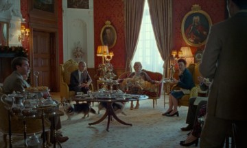 The Royal Family relaxes in a parlor room in the Princess Diana biopic SPENCER (2021)