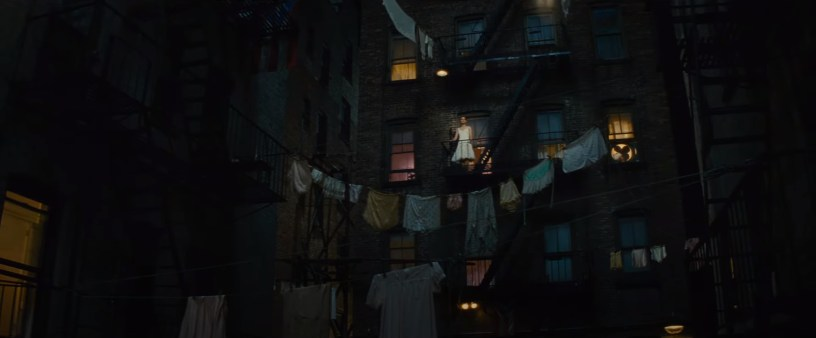Maria (Rachel Zegler) dreams from her balcony about a world that could be in Steven Spielberg's adaptation of WEST SIDE STORY (2021)