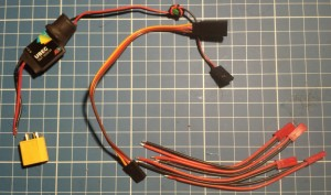 L to R: male XT60 (to connect to LiPO batt), UBEC, (optional) extension cable and then the JST female plugs.