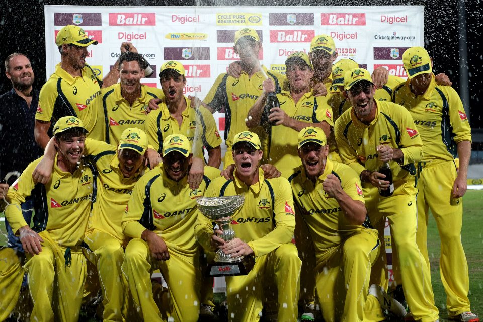 Australia poses with the tri-series cup.
