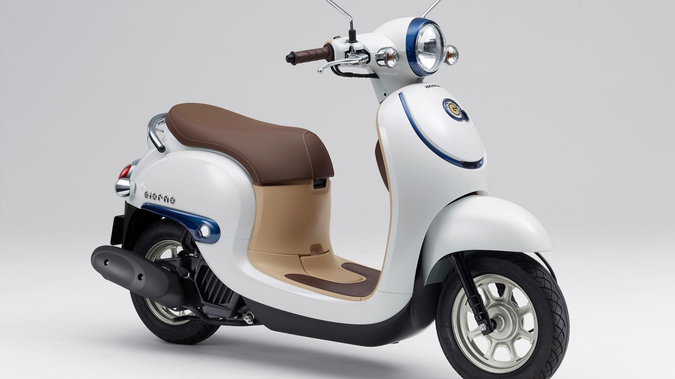 wheel chair motor revolving setting rivals honda and yamaha announce talks to collaborate on