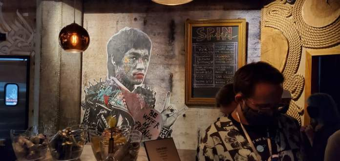 A mural by Bruce Lee painted on the wall of a Seattle bar.