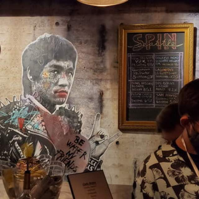 A mural of bruce lee, painted on the wall of a seattle bar.