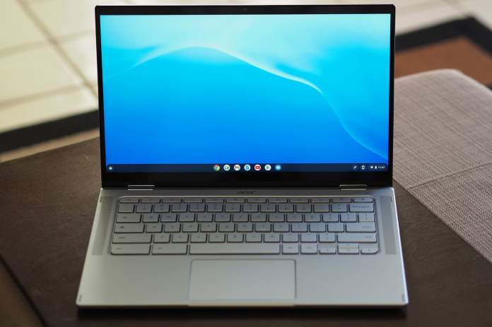 An Acer Chromebook Spin 514 sitting on a table (front view).