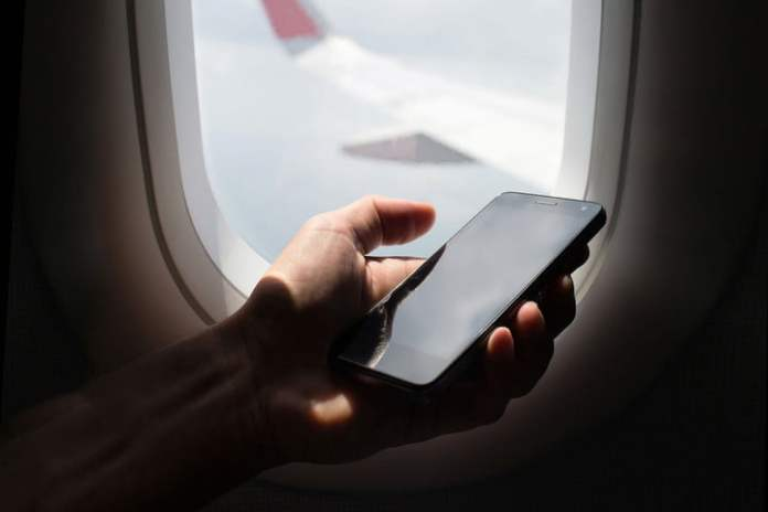 A person turning on Airplane Mode on a smartphone.