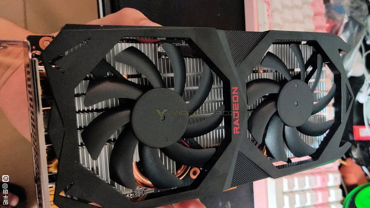 Someone holding a graphics card.