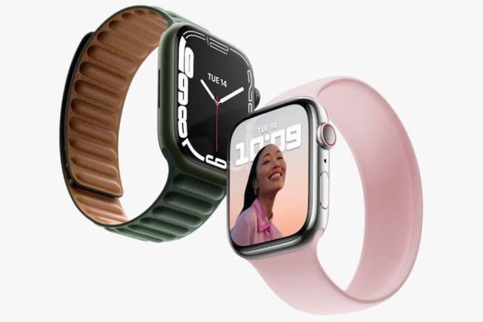 Showing off the Apple Watch Series 7 gray and pink sport bands.