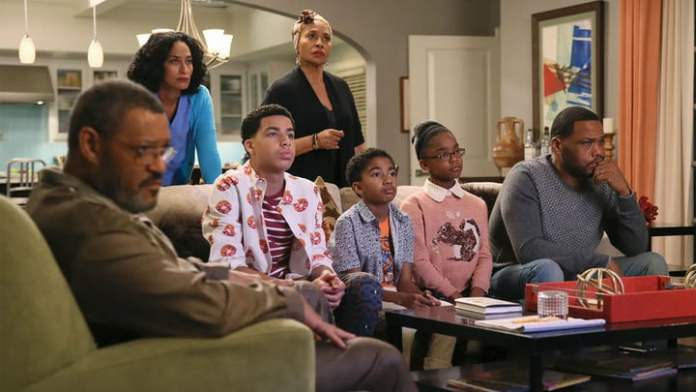 The cast of Black-ish is sitting on a couch.
