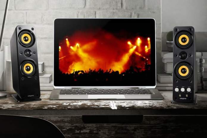 Creative GigaWorks T40 Series II speakers next to a laptop showing the concert.